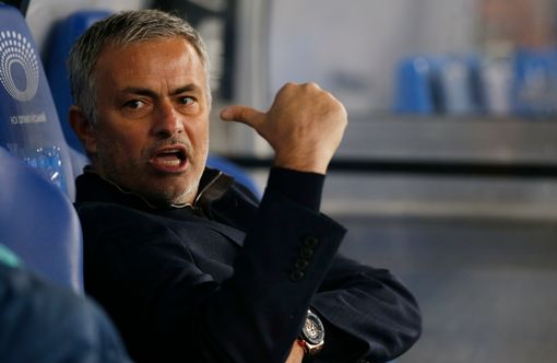 Jose-Mourinho-sits-in-the-dugout-before-the-game